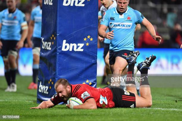 Joe Moody of the Crusaders dives over to score a try during the round 12 Super Rugby match between the Crusaders and the Waratahs at AMI Stadium on...