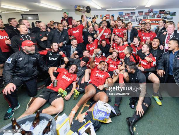 Joe Moody of the Crusaders lifts the Super Rugby Trophy in their dressing room after their win in the Super Rugby Final match between the Crusaders...