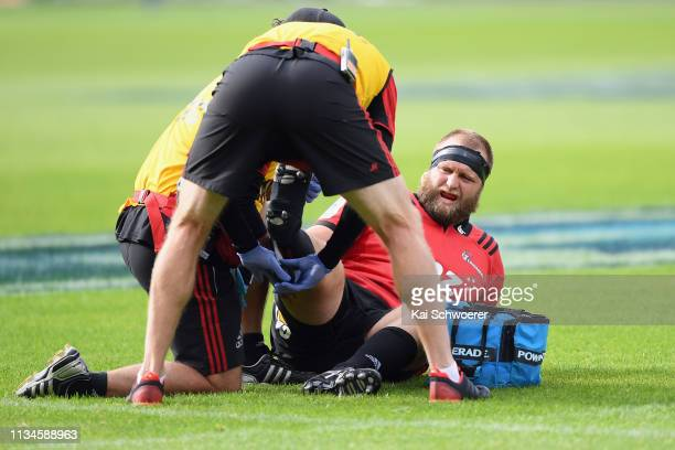 Joe Moody of the Crusaders receives medical help during the round four Super Rugby match between the Crusaders and Chiefs at Christchurch Stadium on...