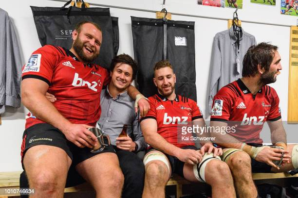 Joe Moody Quinten Strange Luke Romano and Samuel Whitelock celebrate in the dressing room after their win in the Super Rugby Final match between the...
