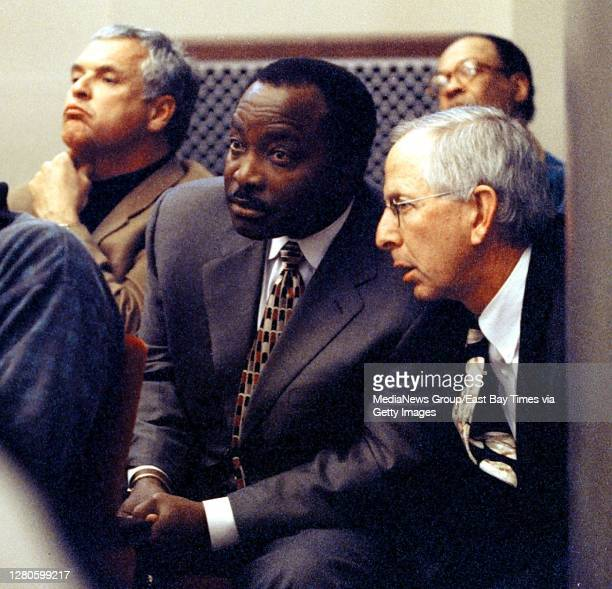 Joe Morgan, center left, and Andy Dolich confer at a special meeting on the sale of the Oakland Athletics on May 6, 1999.