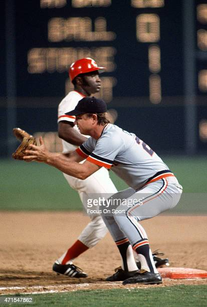 Joe Morgan of the Cincinnati Reds and National League AllStars gets back to first base safe as the throw comes over to Norm Cash of the Detroit...
