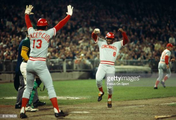 Joe Morgan of the Cincinnati Reds heads for home plate as teammate Dave Concepcion tells him not to slide during the World Series against the Oakland...