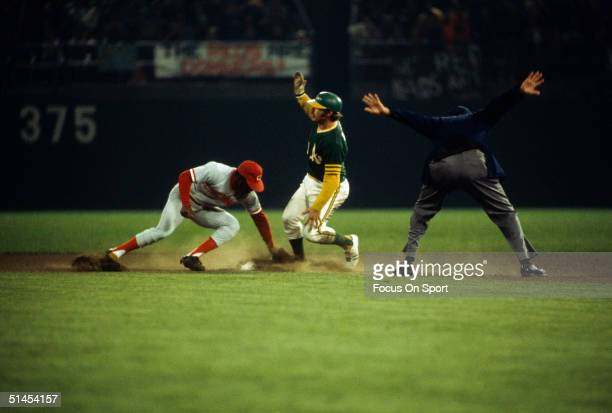 Joe Morgan of the Cincinnati Reds tags out Oakland Athletics' Dick Green at second base during the World Series at OaklandAlameda County Colliseum in...