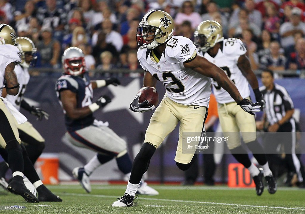 Joe Morgan #13 of the New Orleans Saints gains yardage during a game against the New England Patriots in the first half at Gillette Stadium on August 9, 2012 in Foxboro, Massachusetts.