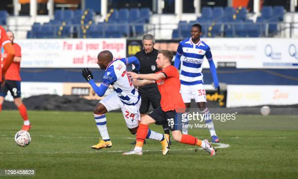 Joe Morrell of Luton Town tackles Sone Aluko of Reading during the FA Cup Third Round match between Luton Town and Reading at Kenilworth Road on...
