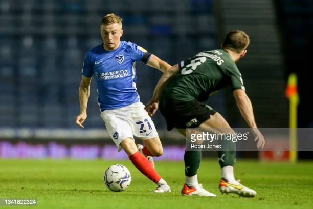 Joe Morrell of Portsmouth FC takes on Joe Edwards of Plymouth Argyle during the Sky Bet League One match between Portsmouth and Plymouth Argyle at...