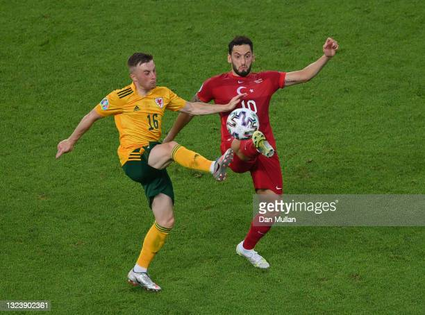 Joe Morrell of Wales battles for possession with Hakan Calhanoglu of Turkey during the UEFA Euro 2020 Championship Group A match between Turkey and...