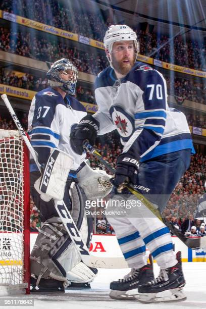 Joe Morrow and Connor Hellebuyck of the Winnipeg Jets defend their goal against the Minnesota Wild in Game Four of the Western Conference First Round...