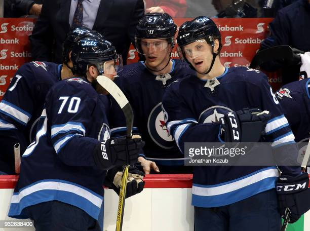 Joe Morrow and Jacob Trouba of the Winnipeg Jets discuss strategy during a third period stoppage in play against the Chicago Blackhawks at the Bell...