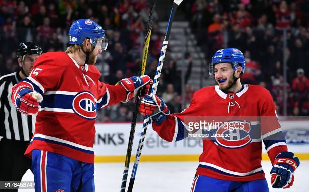 Joe Morrow and Victor Mete of the Montreal Canadiens celebrate a goal against the Anaheim Ducks in the NHL game at the Bell Centre on February 3 2018...