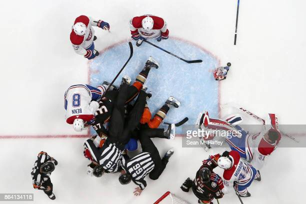 Joe Morrow, Carey Price, Jordie Benn and Joe Morrow of the Montreal Canadiens fight with Nick Ritchie and Ondrej Kase of the Anaheim Ducks during the...