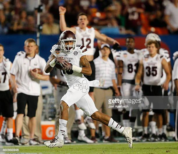Joe Morrow of the Mississippi State Bulldogs runs with the ball against the Georgia Tech Yellow Jackets during the 2014 Capital One Orange Bowl at...