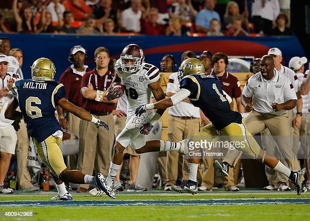 Joe Morrow of the Mississippi State Bulldogs rushes as Chris Milton and Isaiah Johnson of the Georgia Tech Yellow Jackets defend during the first...