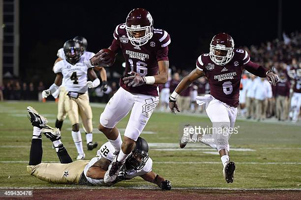 Joe Morrow of the Mississippi State Bulldogs scores a touchdown over Andrew Williamson of the Vanderbilt Commodores during the first quarter of a...