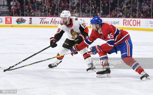 Joe Morrow of the Montreal Canadiens battle for the puck against Derick Brassard of the Ottawa Senators in the NHL game at the Bell Centre on...