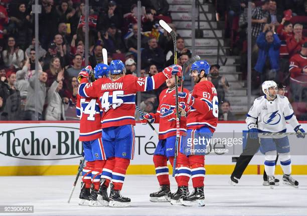 Joe Morrow of the Montreal Canadiens celebrates with teammates after scoring a goal against the Tampa Bay Lightning in the NHL game at the Bell...