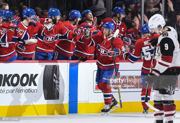 Joe Morrow of the Montreal Canadiens celebrates with the bench after scoring a goal against the Arizona Coyotes in the NHL game at the Bell Centre on...