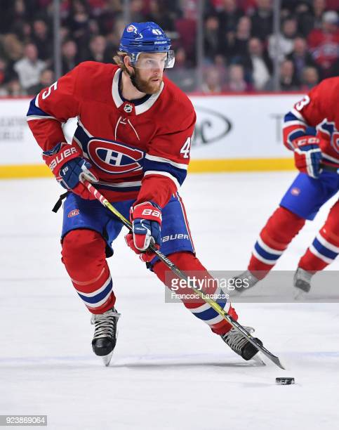 Joe Morrow of the Montreal Canadiens looks to pass the puck against the New York Rangers in the NHL game at the Bell Centre on February 22 2018 in...