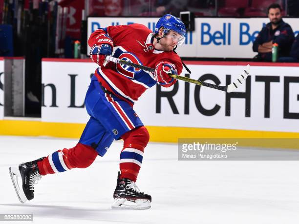 Joe Morrow of the Montreal Canadiens takes a shot during the warmup prior to the NHL game against the Calgary Flames at the Bell Centre on December 7...