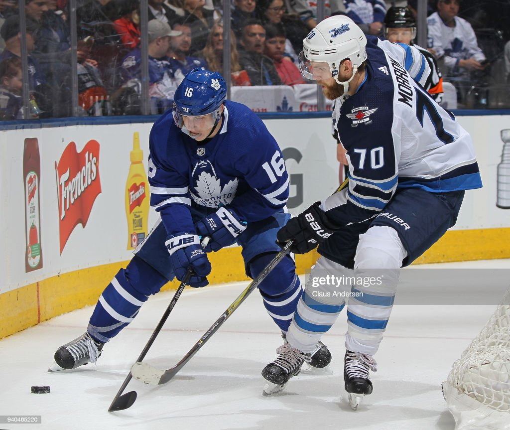 Joe Morrow #70 of the Winnipeg Jets battles against Mitchell Marner #16 of the Toronto Maple Leafs during an NHL game at the Air Canada Centre on March 31, 2018 in Toronto, Ontario, Canada. The Jets defeated the Maple Leafs 3-1.
