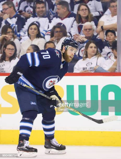 Joe Morrow of the Winnipeg Jets gets set during a first period faceoff against the Minnesota Wild in Game Five of the Western Conference First Round...