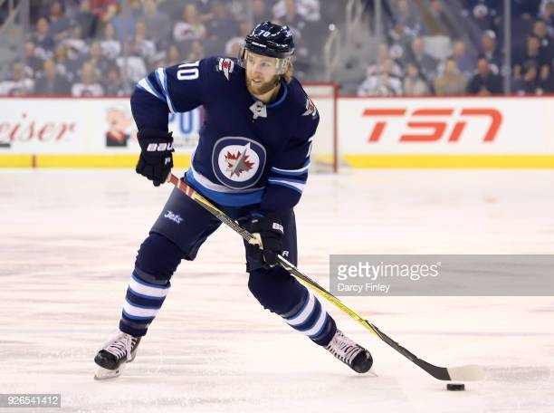 Joe Morrow of the Winnipeg Jets gets set to take a shot from the point during first period action against the Detroit Red Wings at the Bell MTS Place...