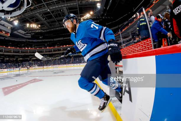 Joe Morrow of the Winnipeg Jets hits the ice for the start of the pregame warm up prior to NHL action against the Colorado Avalanche at the Bell MTS...