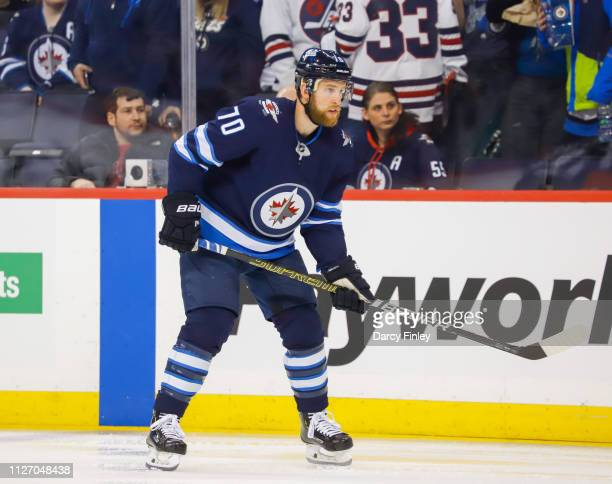 Joe Morrow of the Winnipeg Jets keeps an eye on the play during first period action against the Columbus Blue Jackets at the Bell MTS Place on...