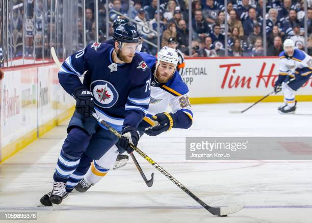 Joe Morrow of the Winnipeg Jets plays the puck down the ice as Ryan O'Reilly of the St Louis Blues gives chase during third period action at the Bell...