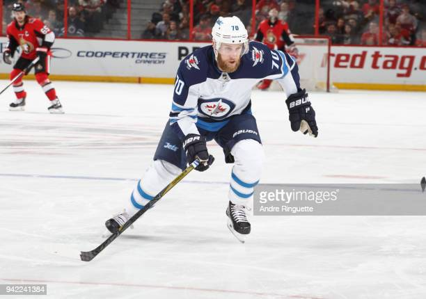 Joe Morrow of the Winnipeg Jets skates against the Ottawa Senators at Canadian Tire Centre on April 2 2018 in Ottawa Ontario Canada