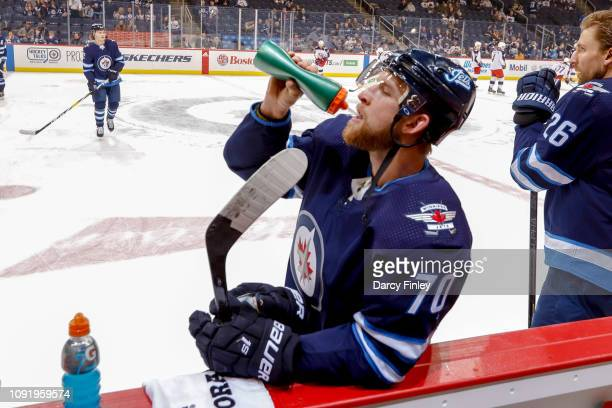 Joe Morrow of the Winnipeg Jets stays hydrated during the pregame warm up prior to NHL action against the Columbus Blue Jackets at the Bell MTS Place...
