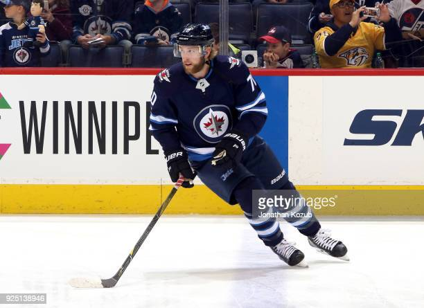 Joe Morrow of the Winnipeg Jets takes part in the pregame warm up prior to NHL action against the Nashville Predators at the Bell MTS Place on...