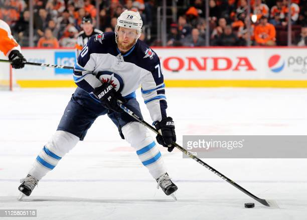 Joe Morrow of the Winnipeg Jets takes the puck in the third period against the Philadelphia Flyers at Wells Fargo Center on January 28 2019 in...