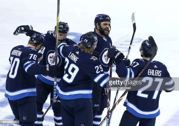 Joe Morrow Paul Stastny Patrik Laine Dustin Byfuglien and Nikolaj Ehlers of the Winnipeg Jets celebrate Morrow's gamewinning goal against the...