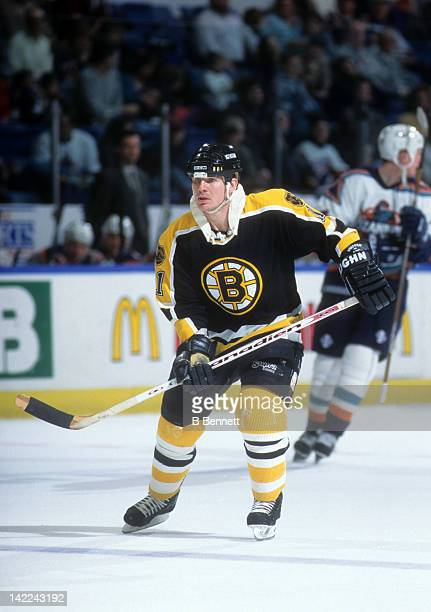 Joe Mullen of the Boston Bruins skates on the ice during an NHL game against the New York Islanders on March 5 1996 at the Nassau Coliseum in...