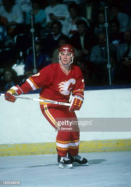 Joe Mullen of the Calgary Flames skates on the ice during an NHL game against the New York Islanders circa 1990 at the Nassau Coliseum in Uniondale...