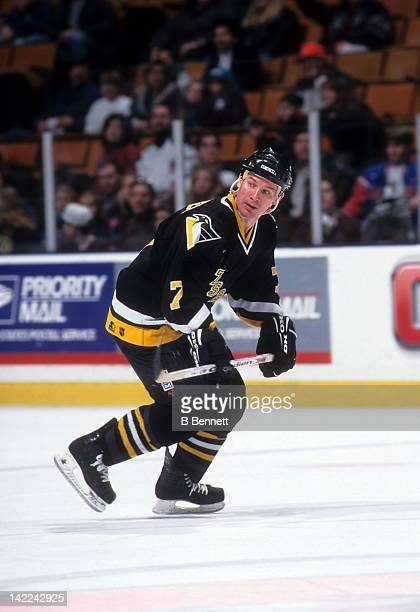Joe Mullen of the Pittsburgh Penguins skates on the ice during an NHL game against the New York Islanders on January 7 1997 at the Nassau Coliseum in...