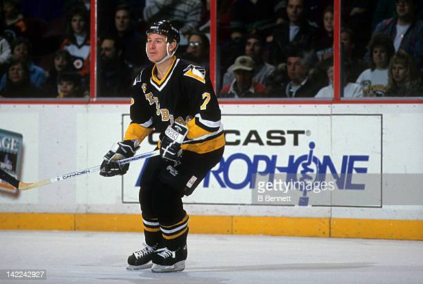 Joe Mullen of the Pittsburgh Penguins skates on the ice during an NHL game against the Philadelphia Flyers on February 13, 1994 at the Spectrum in...