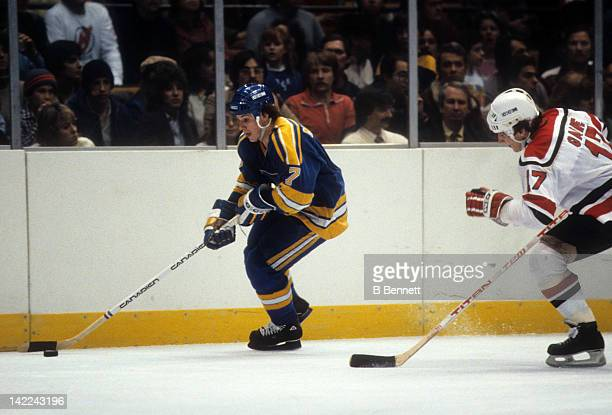 Joe Mullen of the St Louis Blues skates with the puck during an NHL game against the New Jersey Devils on January 20 1983 at the Brendan Byrne Arena...
