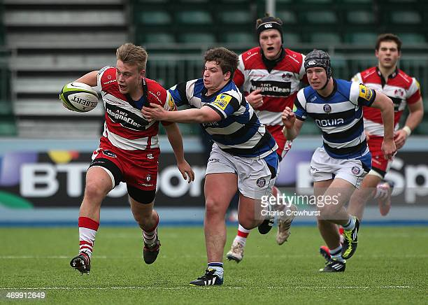 Joe Mullis of Gloucester holds off Dan Frost of Bath during the The U18 Academy Finals Day match between Bath and Gloucester at Allianz Park on...