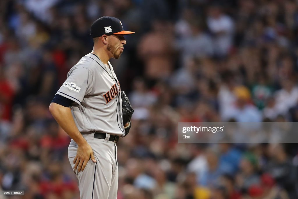 Joe Musgrove #59 of the Houston Astros reacts after a three-run home run by Jackie Bradley Jr. #19 of the Boston Red Sox (not pictured) in the seventh inning during game three of the American League Division Series at Fenway Park on October 8, 2017 in Boston, Massachusetts.