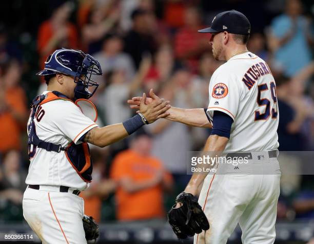 Joe Musgrove of the Houston Astros shakes hands with Juan Centeno after the final out against the Chicago White Sox at Minute Maid Park on September...