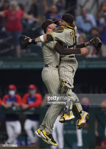 Joe Musgrove of the San Diego Padres celebrates with Victor Caratini after pitching a no-hitter against the Texas Rangers at Globe Life Field on...