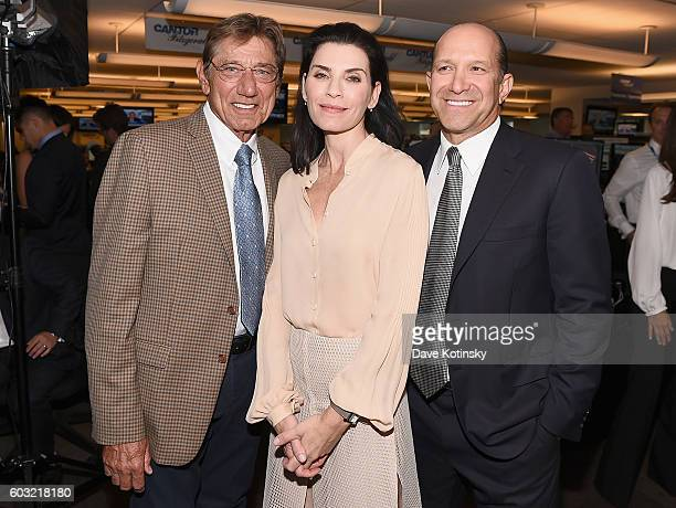 Joe Namath Julianna Margulies and Howard W Lutnick attend the Annual Charity Day hosted by Cantor Fitzgerald BGC and GFI at Cantor Fitzgerald on...