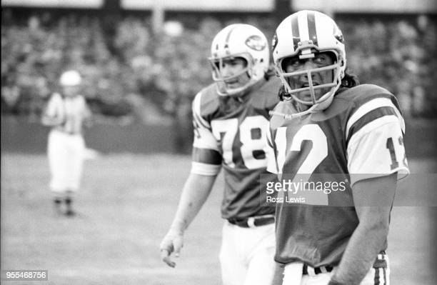 Joe Namath, NY Jets Quarterback, walks off the field during a game with the Miami Dolphins at Shea Stadium on Nov. 24, 1974 in Queens, New York.