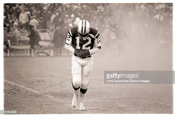 Joe Namath of the New York Jets walks off the field durinbg the AFL Championship Game against the Kansas City Chiefs in Shea Stadium on December 20...