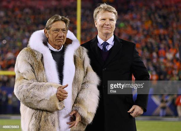 Joe Namath talks with Phil Simms prior to start of Super Bowl XLVIII between the Denver Broncos and the Seattle Seahawks at MetLife Stadium on...