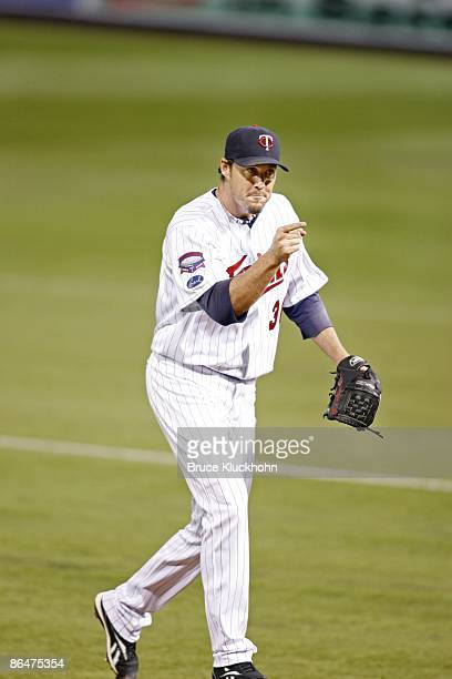 Joe Nathan of the Minnesota Twins celebrates his save and the team's win over the Los Angeles Angels at the Metrodome on April 17 2009 in Minneapolis...