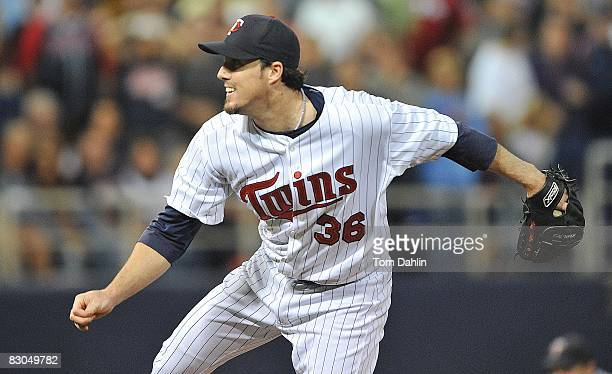 Joe Nathan of the Minnesota Twins delivers a pitch during an MLB game against the Chicago White Sox at the Hubert H Humphrey Metrodome September 24...